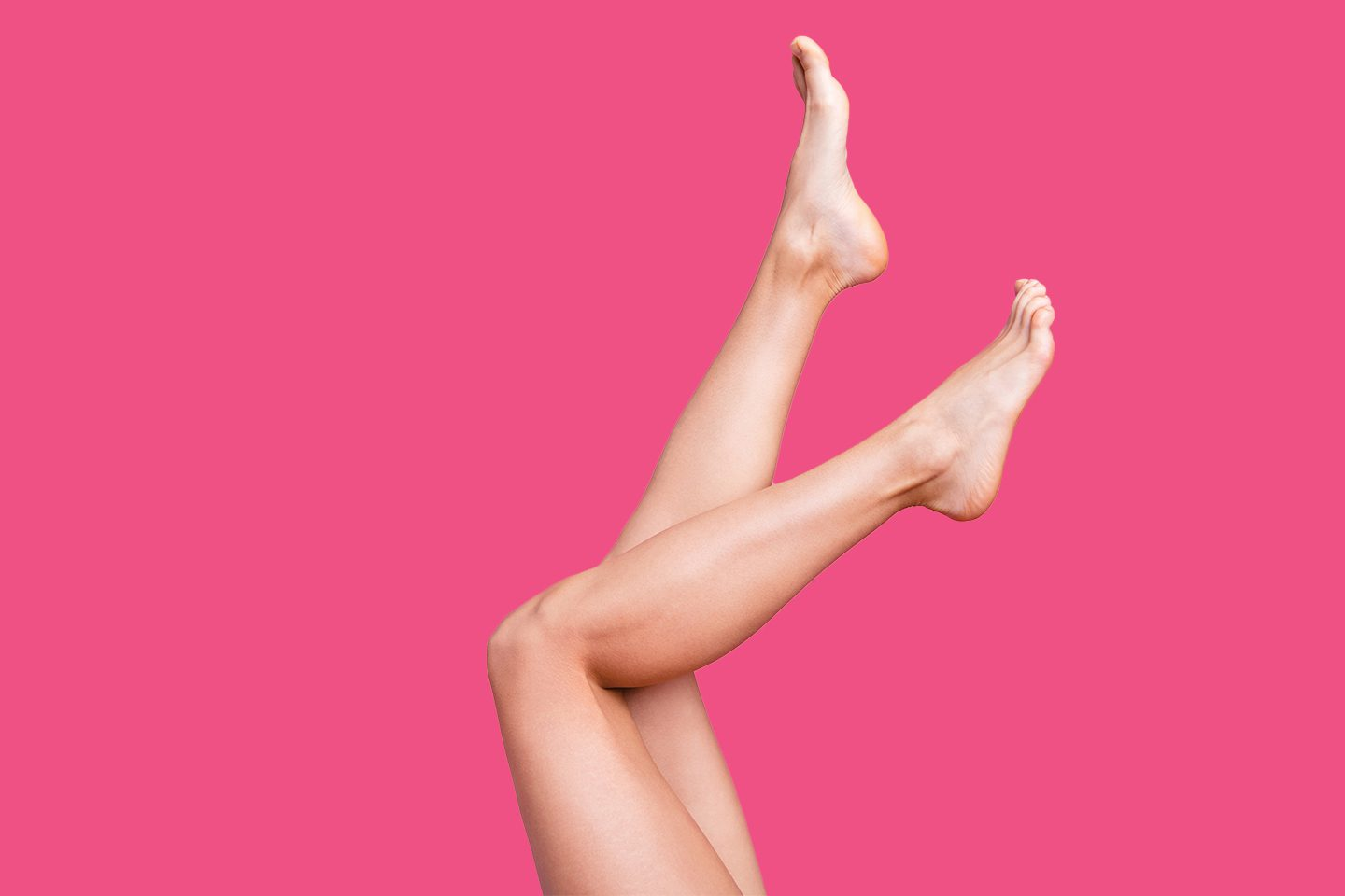 Woman's legs kicking up into the air on a hot pink background